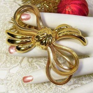 R-1702 MONET High Polish Golden Serpentine Bow Pin